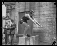 Mariechen M. Wehselau, future Olympic Gold Medal winner, posing for a dive, Los Angeles, 1924