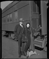 Fay Webb Vallee, wife of bandleader Rudy Vallee, at a train station with her father Clarence Webb, 1933