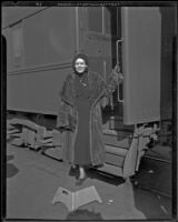 Mrs. Fay Webb Vallee, wife of bandleader Rudy Vallee, at a train station, 1933