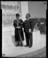 Sculptress Julia Bracken Wendt and Mayor Frank Shaw next to a newly dedicated fountain that includes her work, Los Angeles, 1933