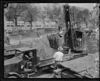 Steam shovel begins excavation for the new Frank Wiggins Trade School Building, Los Angeles, 1926