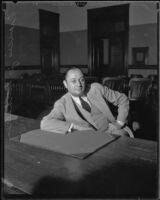 Business man Francis Verhaeren sits at the plaintiff table during a slander trial, Los Angeles, 1931
