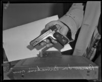 Filmmaker William von Brincken's gun, which police claim proved he lied about an attack on him and his wife, Los Angeles, 1933