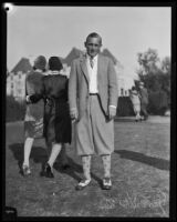George Von Elm, dressed for golf, smokes a cigarette at the Wilshire Country Club, circa 1924-1938
