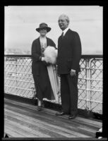 USC President Dr. Rufus von Kleinsmid and his wife Elisabeth on board a ship, San Pedro, 1923-1932