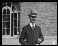 USC President Dr. Rufus B. von Kleinsmid walking around the campus, Los Angeles, 1923