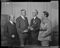 USC President Dr. Rufus B. von Kleinsmid receives a diploma from French Consul Henri Didot, Los Angeles, 1928