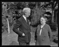 Dr. Rufus B. Von Kleinsmid, USC president, speaks with an unidentified woman