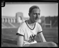 Otto Peltzer, German world record holder in the 880, relaxes at the Coliseum while training to race, Los Angeles, 1928