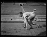 German track star Otto Peltzer practices starts on the track at the Coliseum, Los Angeles, 1928