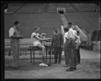 German track star Otto Peltzer talks with some local boys during a training exercise at the Coliseum, Los Angeles, 1928