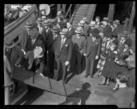 Jurors wait to board Walter Wanderwell's yacht, Carma, during the trial of William James (Curly) Guy, Los Angeles, 1933