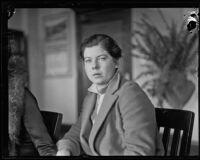 Helen Wilkinson looks to the camera during legal proceedings against Dorothy Mackaye and Paul Kelly, Los Angeles, 1927