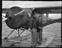 Robert Wilson and Dr. F.A. Fender with Dr. Light's seaplane, San Pedro, 1935