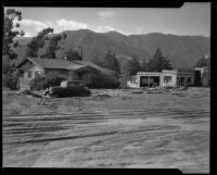 Automobile repair business and house damaged by the catastrophic January mudslide, La Crescenta-Montrose, 1934