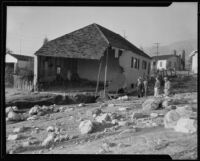 House with one side torn out and gutted by a catastrophic flood and mudslide, La Crescenta-Montrose, 1934