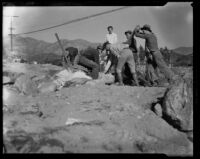 Group of men moving boulders after a catastrophic mudslide, La Crescenta-Montrose, 1934