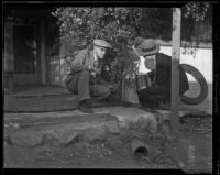 Two men on the porch of a house after a catastrophic flood and mudslide, Montrose and La Crescenta, 1934