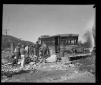 Group of men clearing debris from around a bus after a catastrophic flood and mudslide, La Crescenta-Montrose, 1934