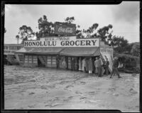 Auto Electrical and Honolulu Grocery damaged by the October flood and mudslide, La Crescenta-Montrose, 1934