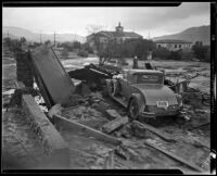 Car surrounded by flood and mudslide debris behind the Holy Redeemer Church, La Crescenta-Montrose, 1934