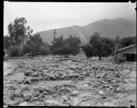 Mud-and-rock-strewn area next to a destroyed house after a catastrophic flood and mudslide, La Crescenta-Montrose, 1934