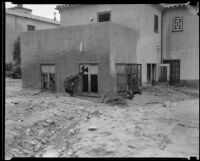 Building with mud up to the window sills after a catastrophic flood and mudslide, La Crescenta-Montrose, 1934
