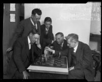 B. G. Adams and Dr. Emanuel Lasker play chess as other watch at the L.A.A.C., Los Angeles, 1926