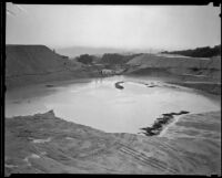 Remaining pond in a runoff area following a catastrophic flood and mudslide, La Crescenta-Montrose, 1934