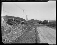 Boulder deposited in the middle of Foothill Boulevard by a catastrophic flood and mudslide, La Crescenta-Montrose, 1934