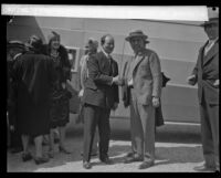 Anthony Fokker and Harris M. Hanshue pose as they shake hands, [Montebello?], [1928]