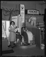 Woman stands in front of the Standard Oil Company exhibit at the Food and Household Show, Los Angeles, 1933