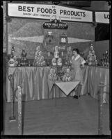 Billie Johnson stands in front of the Best Foods exhibit at the Food and Household Show, Los Angeles, 1933