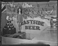 Girl stands in front of the Eastside Beer exhibit at the Food and Household Show, Los Angeles, 1933