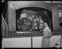 Woman poses in front of the General Foods exhibit at the Food and Household Show, Los Angeles, 1933