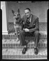 Dr. Boyd S. Gardner sits on a step with a dog, Beverly Hills, 1935