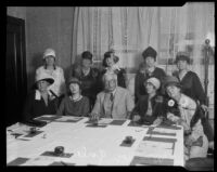 Ruth McClintock, Mrs. E. J. Wightman, Helen Lucille Holt, Ida Koverman, Mrs. Lou La Blonge Whitcomb, Aletha Gilbert, Annie C. Burton, William May Garland, Alma Whitaker, and Mrs. G. Edward Winn gather on behalf of the California Development Association, Los Angeles, 1927