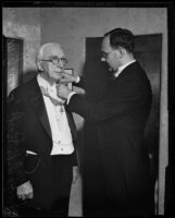 Georg Gyssling places the honor around William May Garland's neck, Los Angeles, 1933
