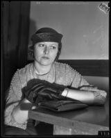 Marjorie Gray is given money in her divorce settlement, Los Angeles, 1934