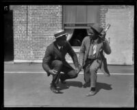 George Godfrey, heavyweight boxer with his brother [outside the KJH Radio studio?], [Los Angeles(?)], circa 1926-1927