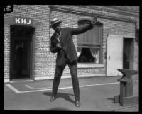 George Godfrey, heavyweight boxer, strikes a boxing pose [outside the KJH Radio studio, Los Angeles(?)], circa 1926-1927