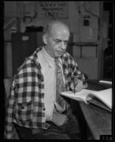 Poet E. B. Goodman writes with his left hand, El Centro, 1934
