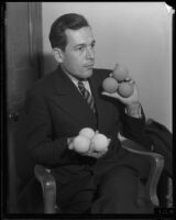 Ben Gorchakoff shows off tennis balls, Los Angeles, 1928