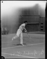 Tennis player Ben Gorchakoff swings his tennis racket, Los Angeles, 1928