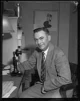 Morley Griswold, Governor of Nevada, poses with telephone, 1934-1935