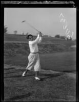 Professional golfer Charlie Guest swings his driver, 1924-1938