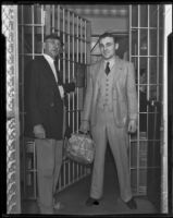 Accused murderer William James (Curly) Guy leaving jail after acquittal as Deputy Sheriff Swan Wilson opens the gate, Long Beach, 1933