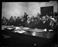 Arraignment of Superior Judge Walter S. Gates on bribery acceptance charges, in court with defense attorneys and his wife, Los Angeles, 1932