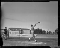 USC Trojan track and field athlete Bob Hall throwing discus, Los Angeles, 1929-1932
