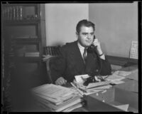 U.S. Attorney Peirson M. Hall at his desk on the phone, Los Angeles, 1933-1937